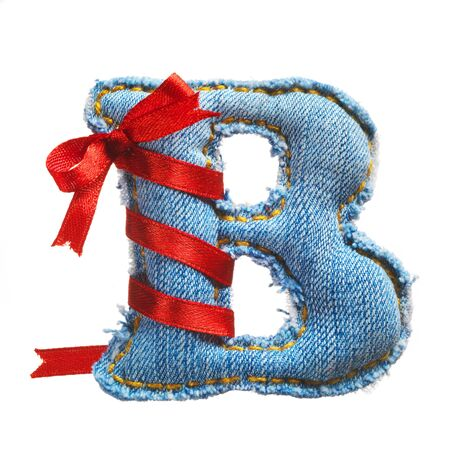 Handmade letter of jeans alphabet with holiday red ribbon isolated on white Stock Photo - 17604302