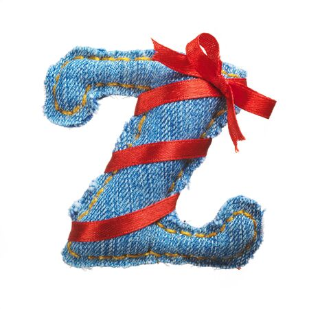 Handmade letter of jeans alphabet with holiday red ribbon isolated on white Stock Photo - 17604279