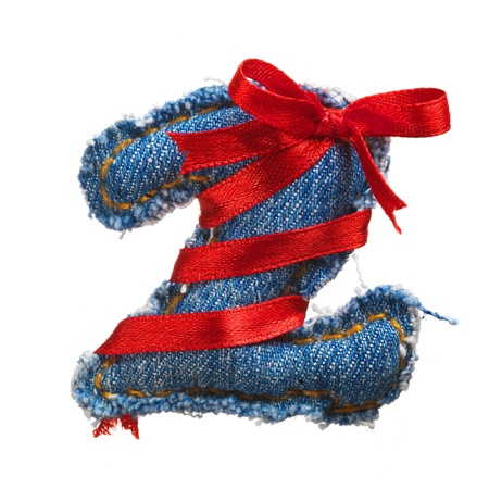 Jeans alphabet digit with holiday red ribbon isolated on white photo