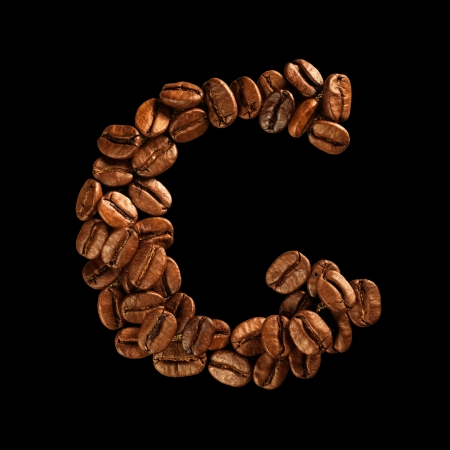 Coffee alphabet letter isolated on black photo