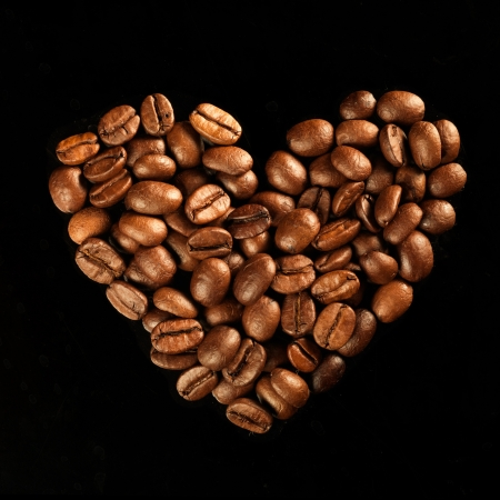 Valentine day heart from coffee beans on black background Stock Photo - 17604284