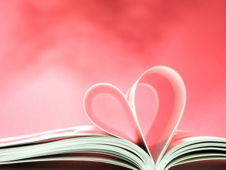 pages of a book curved into a heart shape Stock Photo - 17604319