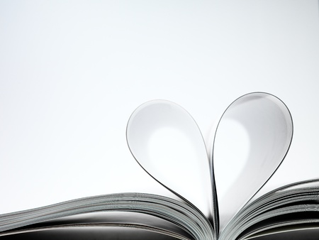 pages of a book curved into a heart shape Stock Photo - 17604308