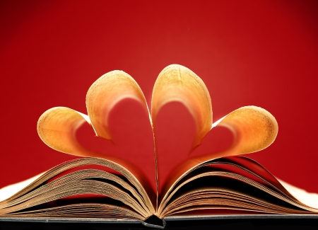 pages of a book curved into a heart shape Stock Photo - 17604321
