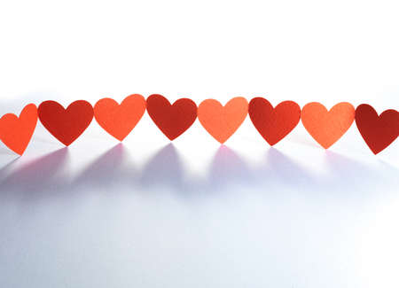 Group of red valentine hearts connected in chain, paper craft Stock Photo - 17604309