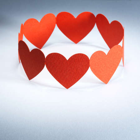 Group of red valentine hearts connected in chain, paper craft  Stock Photo - 17604216