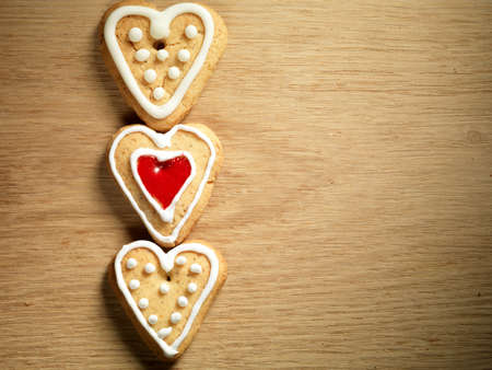 Heart shaped cookies on wooden table background photo