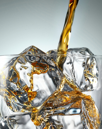 whisky glass: Pouring Scotch Whisky in Glass with perfect ice