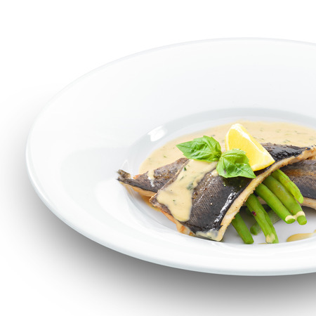 sause: Delicious trout fish fillet grilled and served with basil sause and green beans. Isolated on white