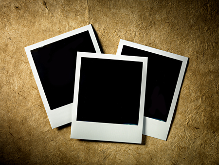 Polaroid Vintage empty photo cards on paper background  photo