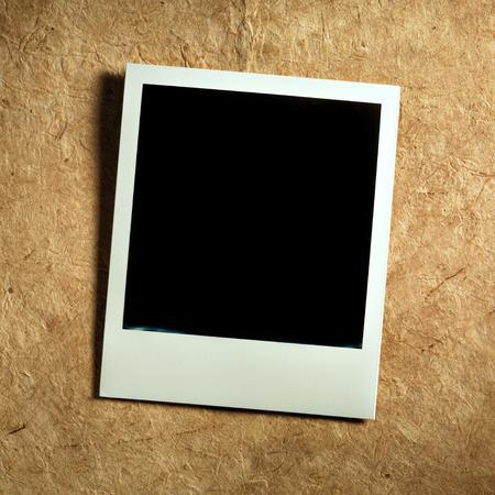 Polaroid Film Vintage empty photo card on paper background photo