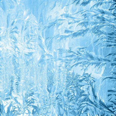 frost winter: Frosty pattern on window in winter season.