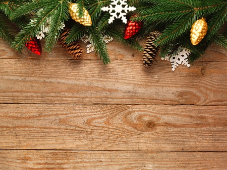 christmas table: Christmas fir tree with decoration on a wooden board. Stock Photo