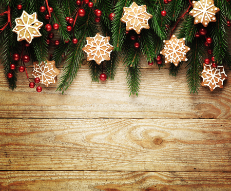 christmas tree branch: Christmas fir tree with decoration on a wooden board. Stock Photo