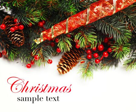 boarder: Christmas background. Christmas boarder with fir tree branch with cones and ornament. Christmas baubles in golden and red colour. Close up with copy space and sample text. Winter holidays concept. Stock Photo