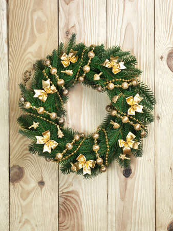 Christmas wreath on the wood door.