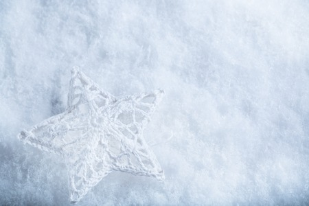 Beautiful star on a white frost snow background. Winter and Christmas concept. Instagram filter. Фото со стока
