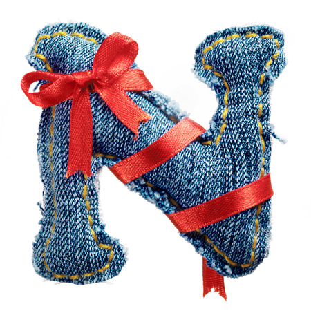 torn jeans: Magic holiday jeans alphabet letter N with red ribbon