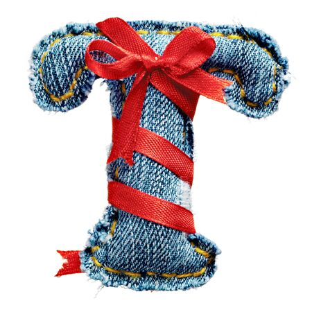 torn jeans: Magic holiday jeans alphabet letter T with red ribbon Stock Photo