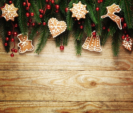 pine tree needles: Christmas fir tree with decoration on a wooden board. Stock Photo