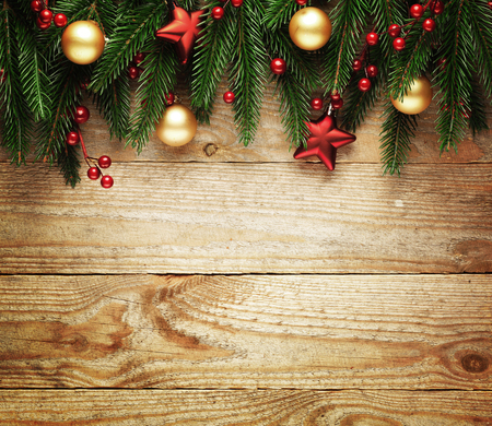 christmas bell: Christmas fir tree with decoration on a wooden board. Stock Photo