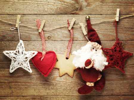 holiday decor: Festive Christmas decoration over wooden board background. Stock Photo