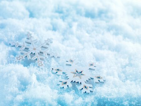 Winter and Christmas background. Beautiful  silver Christmas decorations on a white snow background. Ornamental Christmas concept. Close up with copy space.