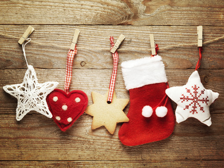 christmas decorations: Festive Christmas decoration over wooden board background. Stock Photo