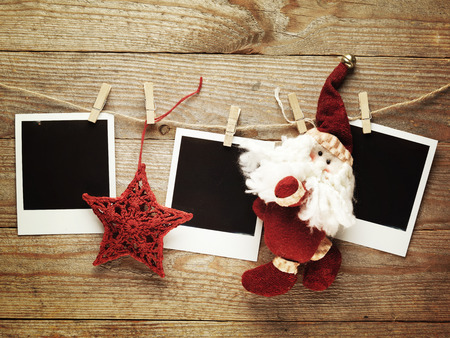 christmas vintage: Vintage photo frames decorated for Christmas on the wooden board background with space for text