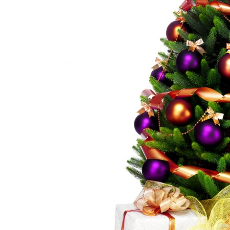 christmas baubles: Decorated Christmas tree on white background. Stock Photo