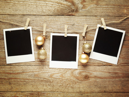 Vintage photo frames decorated for Christmas on the wooden board background with space for your text,