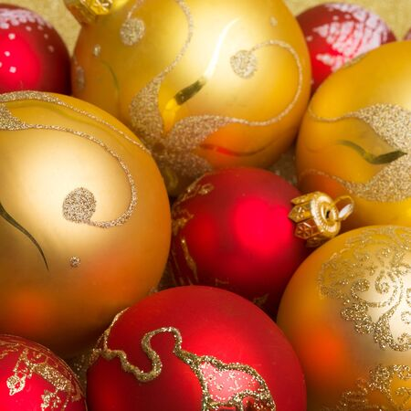 Abstract Christmas gold background with golden holiday balls. Фото со стока