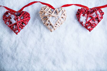 Beautiful romantic vintage hearts on a white frosty snow winter background. Love and St. Valentines Day concept.