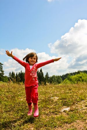foster: Children playing in nature, enjoying in the forest