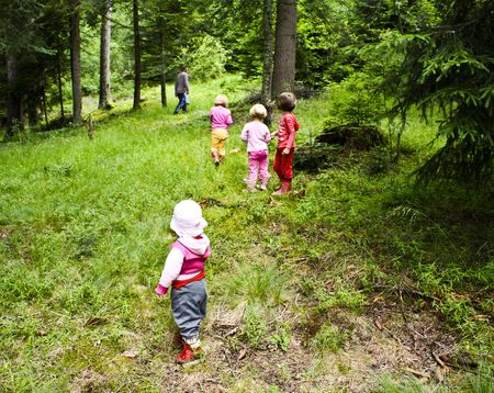 Children playing in nature, enjoying in the forest photo