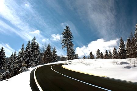 dangerous road: Mountain road in snow Stock Photo