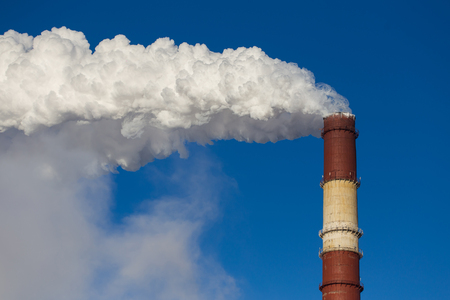 Dense smoke from a pipe in the sky Stock Photo
