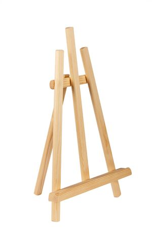 Wooden painter easel isolated on white. academy tripod. Stock Photo