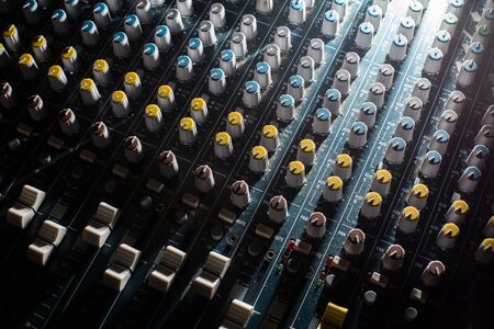 Professional Audio dj mixer console, sound tools and gear, studio equipment picture, selective focus picture of faders and knobs of mixer Stock Photo