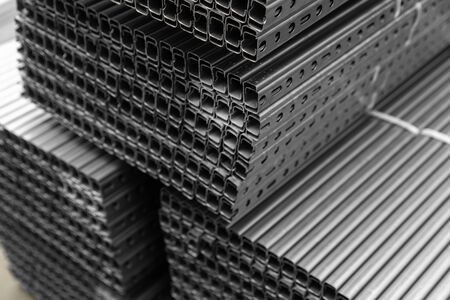 high quality Galvanized steel profile or Aluminum and chrome stainless profiles in stack waiting for shipment Stock Photo