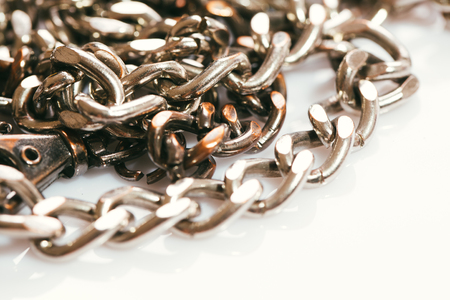 metal chains of various sizes on a white background. Stock Photo