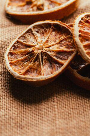 Dried lemon and orange on a light background sacking.