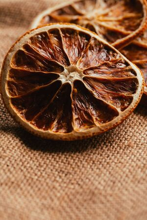 christmas scent: Dried lemon and orange on a light background sacking.