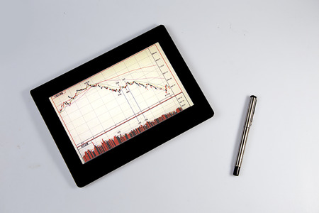 a tablet computer with a pen photo