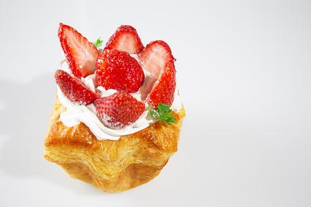 Strawberry cake on white background  photo