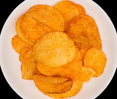 close uo: Close uo potato chip in white dish and black background