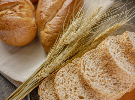Flat lay various of breads on wooden background  Bakery,food concept