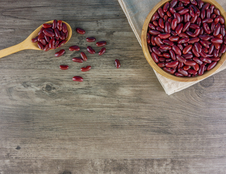 Flat lay red beans on wooden table with copy space Food,ingredients,nature concept Stock Photo