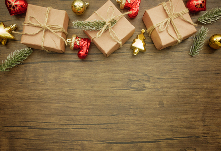 Flat lay,top view Christmas ornaments and Christmas gifts on wooden background with copy space
