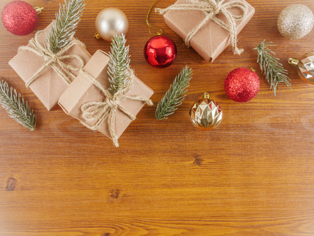 Flat lay,top view Christmas ornaments and gift boxes on wooden background with copy space
